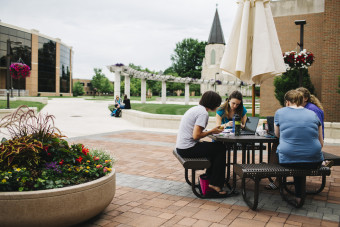 Students studying outside at Indiana Wesleyan.